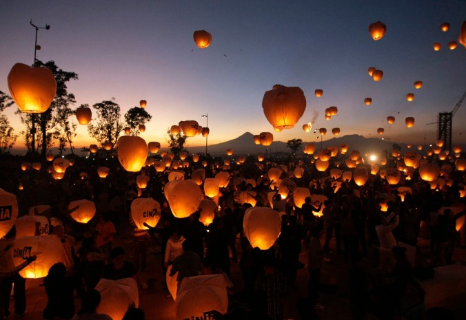 Participants launch sky lanterns during an event in Puebla, near Mexico City